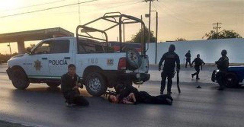 Policía protege a niño de balac3era en Reynosa